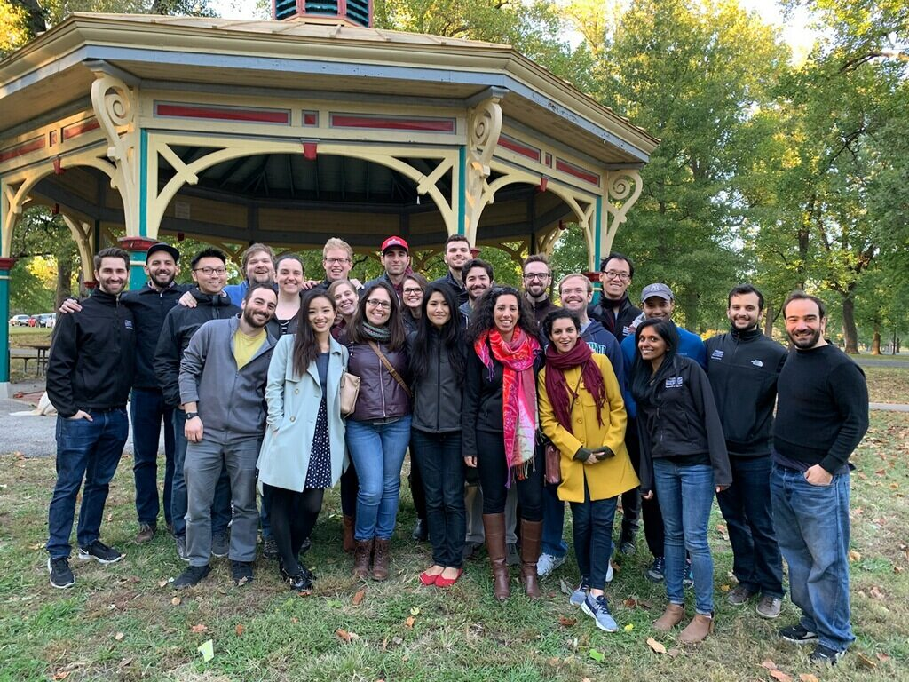 Psychiatry residents gather in front of a pavilion