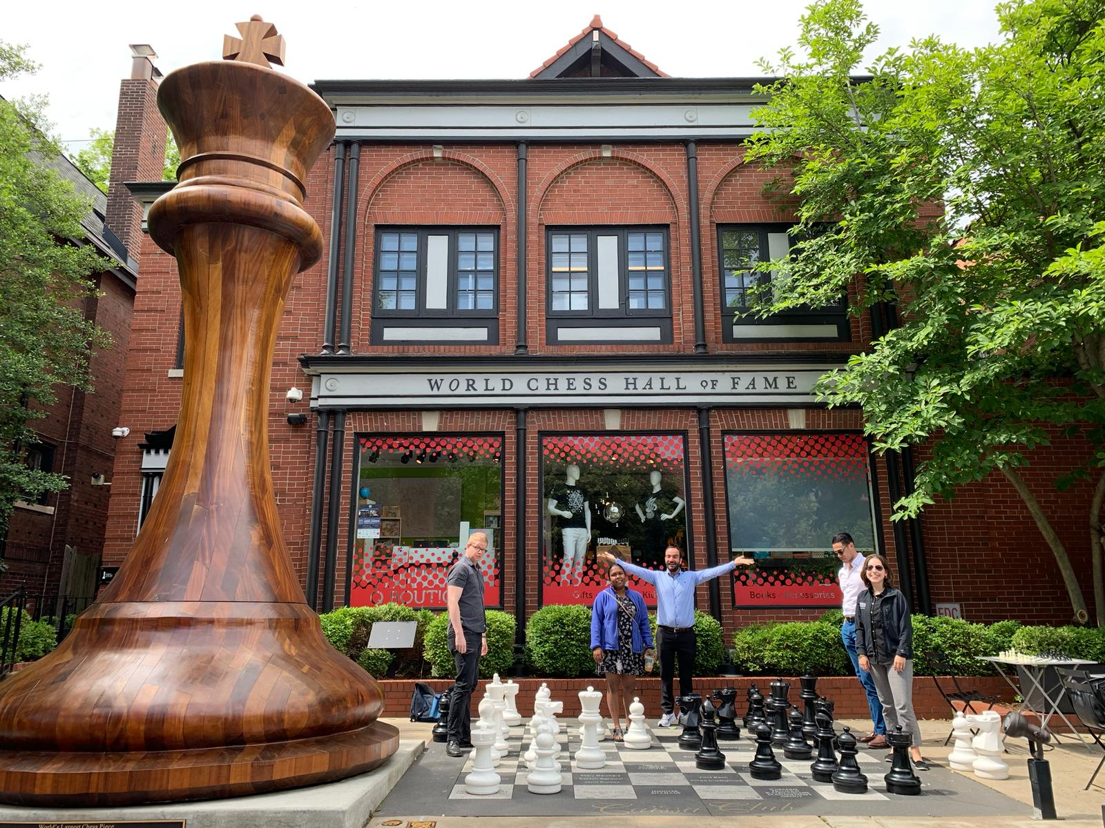 Five residents play chess on giant chessboard outside World Chess Hall of Fame in Central West End